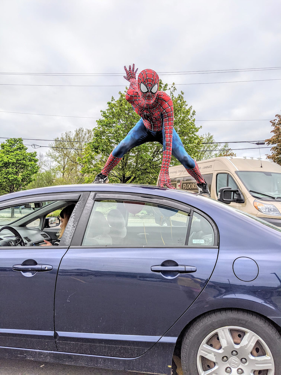 <em>Spider-Man lands on top of his Honda Civic. (Photo courtesy of Mike Justman)</em>
