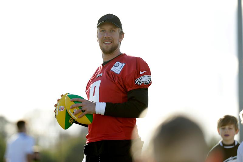Philadelphia Eagles' quarterback Nick Foles joins in with an NFL Flag event for local schoolchildren after an NFL training session at the London Irish rugby team training ground in the Sunbury-on-Thames suburb of south west London, Friday, Oct. 26, 2018. The Philadelphia Eagles are preparing for an NFL regular season game against the Jacksonville Jaguars in London on Sunday. (AP Photo/Matt Dunham)