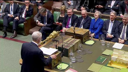 British Prime Minister Theresa May reacts as Jeremy Corbyn, Leader of the Labour Party, speaks during a no confidence debate after Parliament rejected her Brexit deal, in London, Britain, January 16, 2019, in this screen grab taken from video. Reuters TV via REUTERS