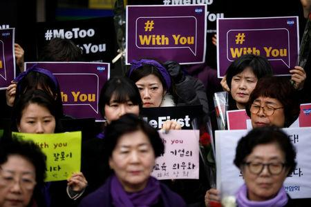 Women attend a protest as a part of the #MeToo movement on International Women's Day in Seoul