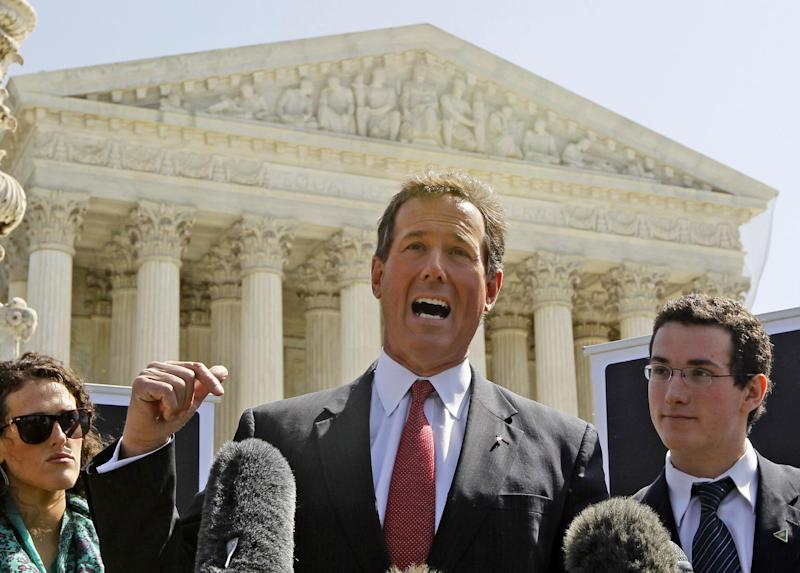 Republican presidential candidate, former Pennsylvania Sen. Rick Santorum, accompanied by his daughter Elizabeth Santorum and son Daniel Santorum, speaks in front of the Supreme Court in Washington, Monday, March 26, 2012, as the court began three days of arguments on the health care law signed by President Barack Obama. (AP Photo/Charles Dharapak)
