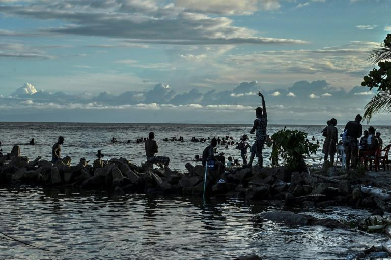 Thousands of migrants, mostly from Haiti, are stranded in the Colombian town of Necocli waiting to get a boat trip to the border with Panama