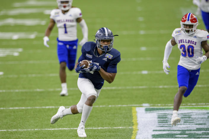 Georgia Southern wide receiver Khaleb Hood (7) scores a touchdown against Louisiana Tech during the first half of the New Orleans Bowl NCAA college football game in New Orleans, Wednesday, Dec. 23, 2020. (AP Photo/Matthew Hinton)
