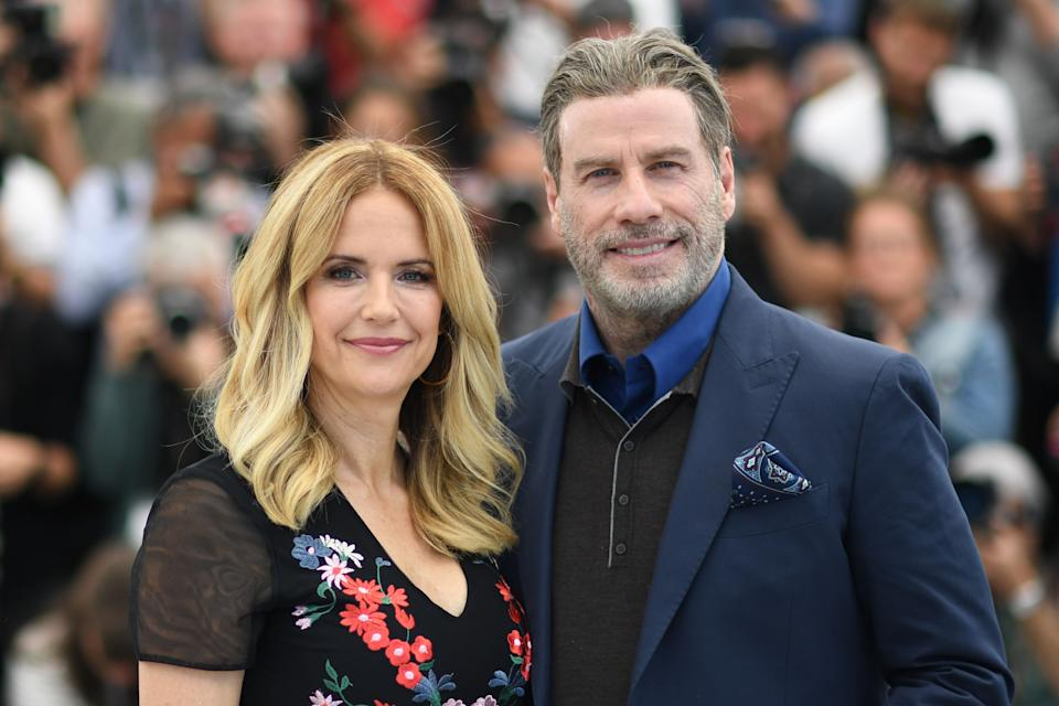 US actor John Travolta (R) and his wife US actress Kelly Preston pose on May 15, 2018 during a photocall for the film