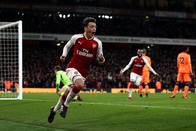 Mesut Ozil celebrates the goal that completed Arsenal's stunning comeback. (Getty)