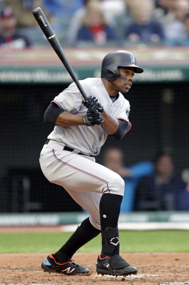 Miami Marlins' Curtis Granderson watches his ball after hitting a one-run double off Cleveland Indians relief pitcher Neil Ramirez in the fifth inning of a baseball game, Tuesday, April 23, 2019, in Cleveland. Isaac Galloway scored on the play. (AP Photo/Tony Dejak)