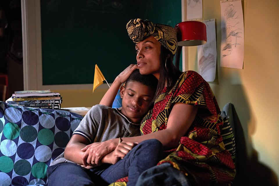 """Mary (Rosario Dawson) embraces her caring son Gunner (Lonnie Chavis) in the family adventure """"The Water Man."""""""