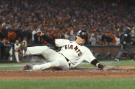 San Francisco Giants' Wilmer Flores scores against the Los Angeles Dodgers during the second inning of Game 2 of a baseball National League Division Series Saturday, Oct. 9, 2021, in San Francisco. (AP Photo/John Hefti)