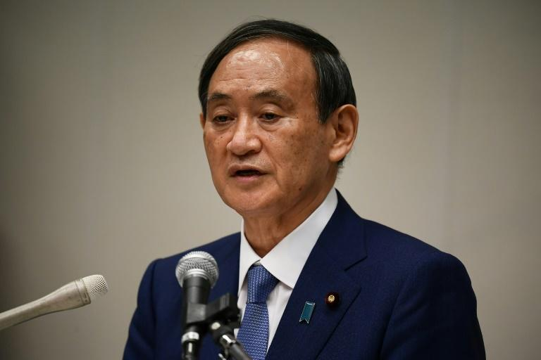 Japan's Suga announces PM run with strong party backing