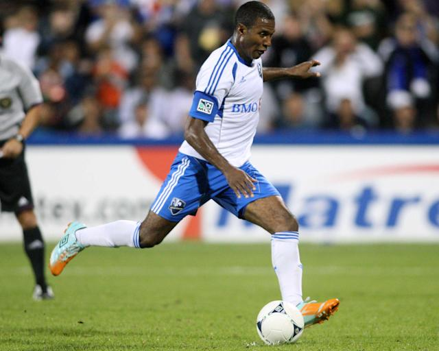 MONTREAL, CANADA - AUGUST 18: Patrice Bernier #8 of the Montreal Impact kicks the ball to score on a penalty kick in the second half of the match against the San Jose Earthquakes at the Saputo Stadium on August 18, 2012 in Montreal, Quebec, Canada. The Impact defeated the Earthquakes 3-1. (Photo by Richard Wolowicz/Getty Images)