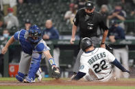 Seattle Mariners' Luis Torrens (22) slides safely home as Los Angeles Dodgers catcher Will Smith attempts the tag during the fourth inning of a baseball game, Monday, April 19, 2021, in Seattle. Torrens scored on a double hit by Taylor Trammell. (AP Photo/Ted S. Warren)
