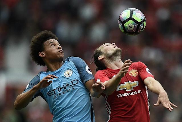 Manchester City's Leroy Sane (left) and Manchester United's Daley Blind in action during the Premier League match at Old Trafford, on September 10, 2016 (AFP Photo/Oli Scarff)