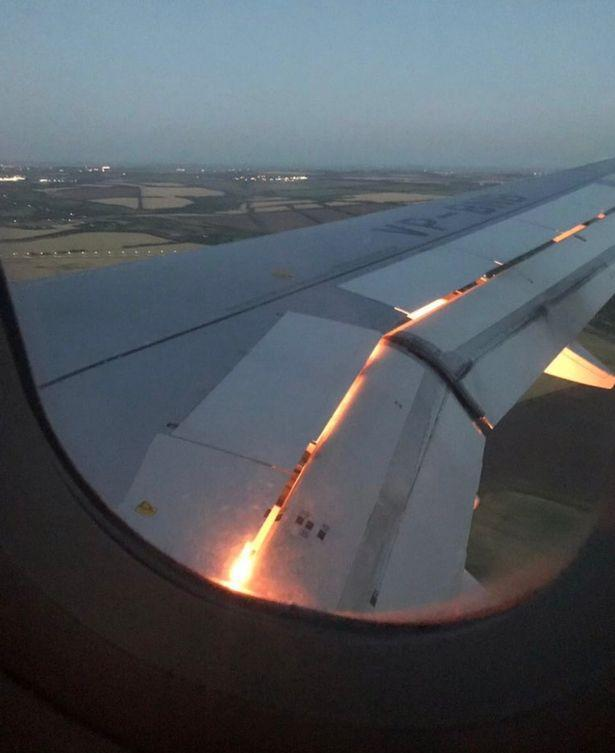 Flames were seen coming out of the Russian Airlines Airbus engine that the Saudi Arabian team rode on. (Image: via @AhmedMashaly24/Twitter)