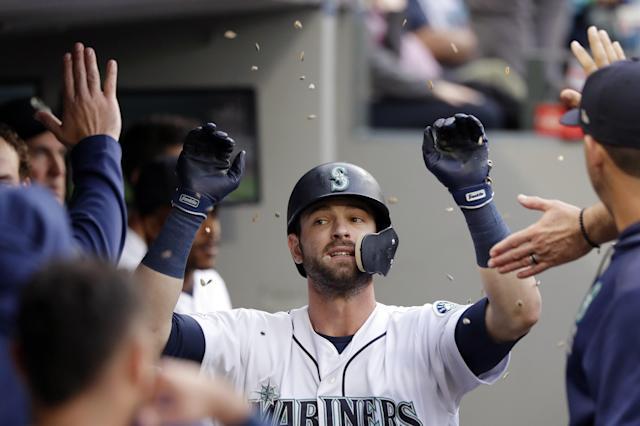 Seattle Mariners' Mitch Haniger is congratulated and showered with sunflower seeds after his solo home run against the Houston Astros in the third inning of a baseball game Tuesday, June 4, 2019, in Seattle. (AP Photo/Elaine Thompson)