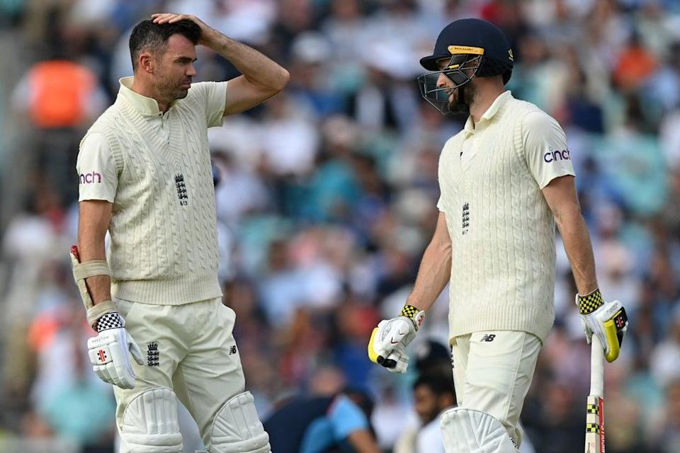 James Anderson (left) talks to Chris Woakes during their last-wicket stand (AFP via Getty Images)