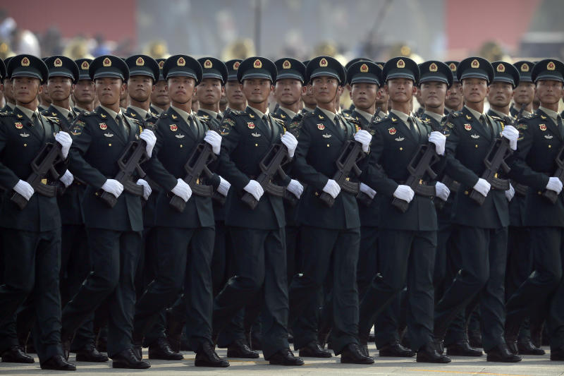 Members of China's People's Liberation Army (PLA) Rocket Force march in formation during a parade to commemorate the 70th anniversary of the founding of Communist China in Beijing, Tuesday, Oct. 1, 2019. Trucks carrying weapons including a nuclear-armed missile designed to evade U.S. defenses rumbled through Beijing as the Communist Party celebrated its 70th anniversary in power with a parade Tuesday that showcased China's ambition as a rising global force. (AP Photo/Mark Schiefelbein)