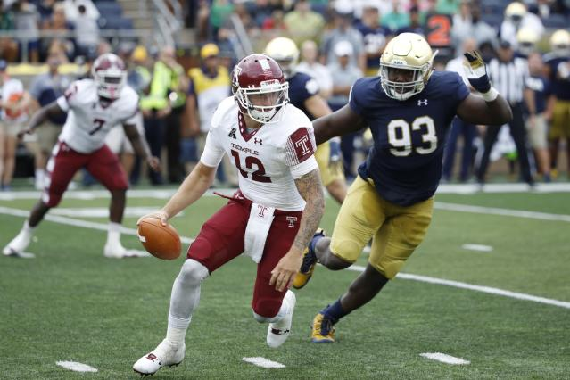 "SOUTH BEND, IN – SEPTEMBER 02: Logan Marchi #12 of the <a class=""link rapid-noclick-resp"" href=""/ncaab/teams/tad"" data-ylk=""slk:Temple Owls"">Temple Owls</a> tries to evade pressure from <a class=""link rapid-noclick-resp"" href=""/ncaaf/players/245071/"" data-ylk=""slk:Jay Hayes"">Jay Hayes</a> #93 of the <a class=""link rapid-noclick-resp"" href=""/ncaaw/teams/nbf"" data-ylk=""slk:Notre Dame Fighting Irish"">Notre Dame Fighting Irish</a> in the third quarter of a game at Notre Dame Stadium on September 2, 2017 in South Bend, Indiana. The Irish won 49-16. (Photo by Joe Robbins/Getty Images)"