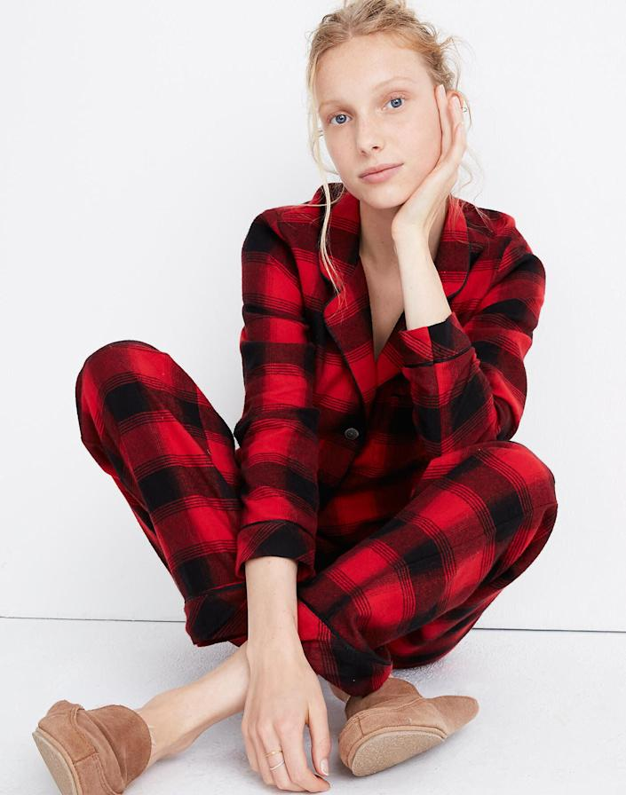 """Nothing's as classic as flannel. These plaid pajamas includes both a top and bottom that'll keep your friend warm all winter long. <strong><a href=""""https://fave.co/34ZIXEK"""" rel=""""nofollow noopener"""" target=""""_blank"""" data-ylk=""""slk:Get it on sale for $70 at Madewell, plus an additional 25% with code GOODCHEER"""" class=""""link rapid-noclick-resp"""">Get it on sale for $70 at Madewell, plus an additional 25% with code GOODCHEER</a></strong>.&nbsp;"""