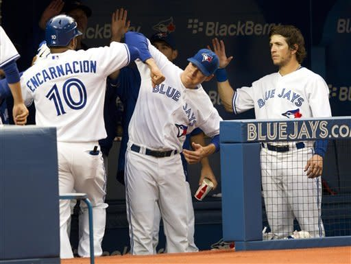 Toronto Blue Jays' Edwin Encarnacion, left, celebrates his home run against the Baltimore Orioles with Kelly Johnson and Colby Rasmus, right, during the second inning of a baseball game, Wednesday, May 30, 2012, in Toronto. (AP Photo/The Canadian Press, Frank Gunn)