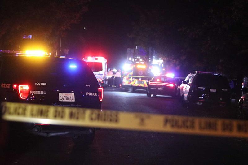 Police have established an Asian gang task force in response to Sunday night's shooting, though no motive or gang affiliation has been determined. (Photo: Fresno Bee via Getty Images)