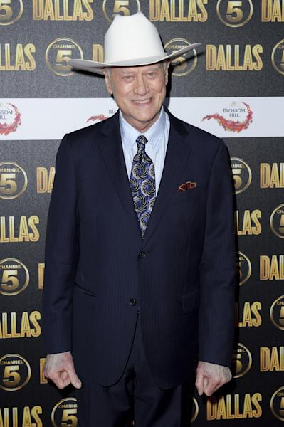 "FILE - In this Aug. 21, 2012 file photo, Larry Hagman arrives for the ""Dallas"" launch party at a venue in central London. The Emmys will honor the late actors Hagman and Jack Klugman as part of an in memoriam package, but the two are not among those singled out for separate tributes. (AP Photo/Jonathan Short, File)"