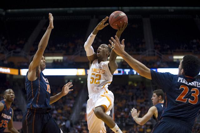 Tennessee's Jordan McRae tries to score while defended by Virginia's Malcolm Brogdon, left, and London Perrantes during an NCAA college basketball game on Monday, Dec. 30, 2013, in Knoxville, Tenn. (AP Photo/The Knoxville News Sentinel, Saul Young)