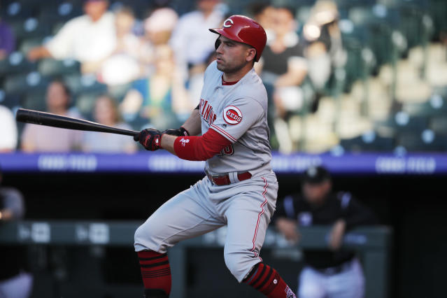 Cincinnati Reds' Joey Votto follows the flight of his single off Colorado Rockies starting pitcher Jon Gray in the first inning of a baseball game Friday, May 25, 2018, in Denver. (AP Photo/David Zalubowski)