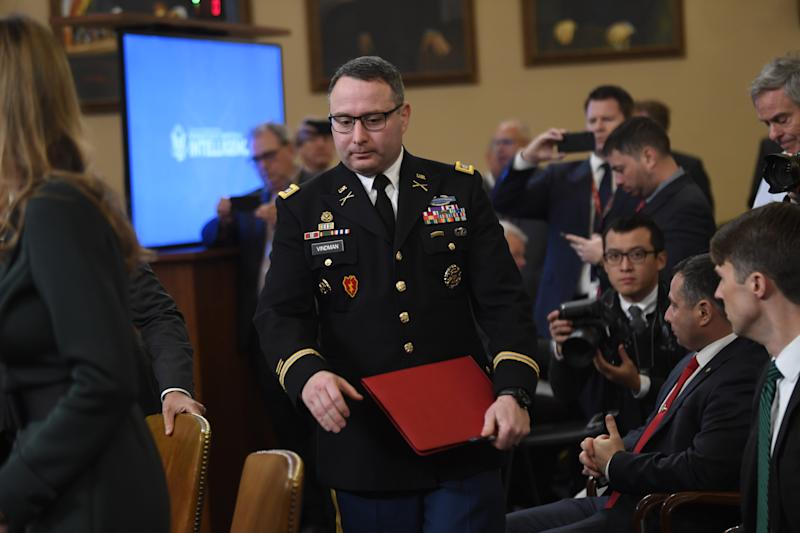 Lt. Col. Alexander Vindman, center, a Ukraine expert for the National Security Council, returns to the hearing room during a break in testimony on Nov. 19, 2019 before the Permanent Select Committee on Intelligence.