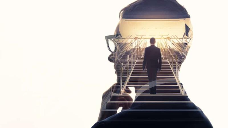 Double exposure of a businessman and stairs - Business Success Concept