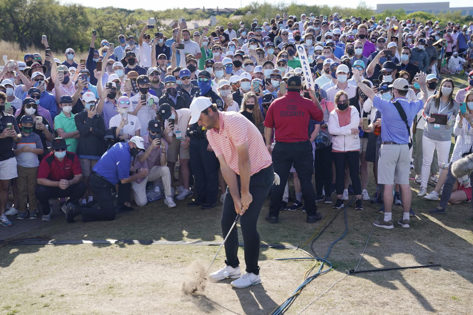 Scottie Scheffler hits his second shot on the 13th hole during the final round of the Dell Technologies Match Play Championship golf tournament Sunday, March 28, 2021, in Austin, Texas. (AP Photo/David J. Phillip)