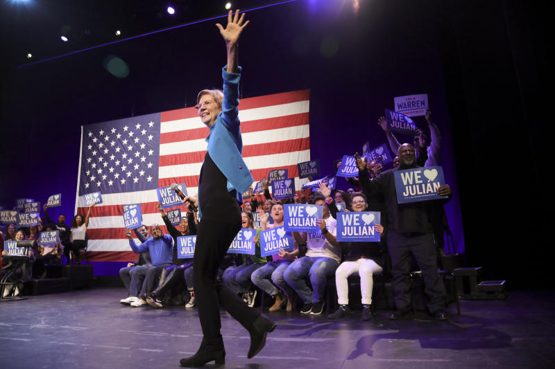 Democratic presidential candidate Sen. Elizabeth Warren, D-Mass., greets supporters during a campaign rally where she appeared with former Secretary of Housing and Urban Development Julian Castro, Tuesday Jan. 7, 2020, at the Kings Theatre in the Brooklyn borough of New York. (AP Photo/Bebeto Matthews)