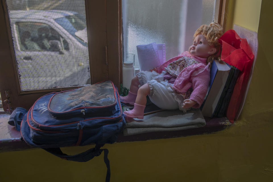 A school bag lies next to a doll belonging to a young Kashmiri student inside her home in Srinagar, Indian controlled Kashmir, Thursday, July 18, 2020. Decades of insurgency, protests and military crackdowns have constantly disrupted formal schooling in Indian-administered Kashmir, where rebels have fought for decades for independence or unification with Pakistan, which controls the other part of the Muslim-majority region. A generation of students have seen their education upended, and empty classrooms are a familiar sight. Now, the coronavirus lockdown is amplifying the problem. (AP Photo/Dar Yasin)