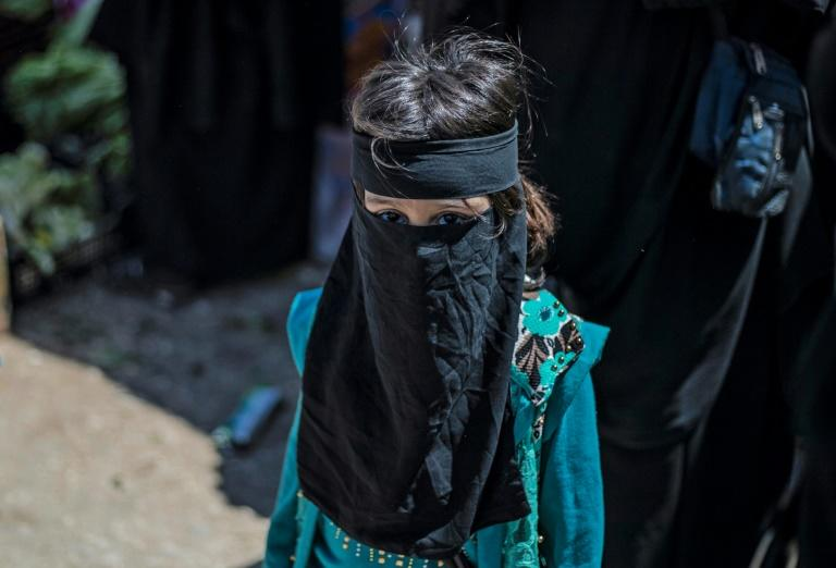 A child in al-Hol camp, where thousands of women and children of IS fighters are living after the collapse of the jihadists' self declared caliphate