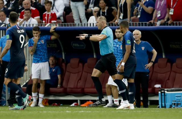 Referee Nestor Pitana from Argentina points to the penalty box after watching the VAR monitor, during the final match between France and Croatia at the 2018 soccer World Cup in the Luzhniki Stadium in Moscow, Russia, Sunday, July 15, 2018. (AP Photo/Petr David Josek)
