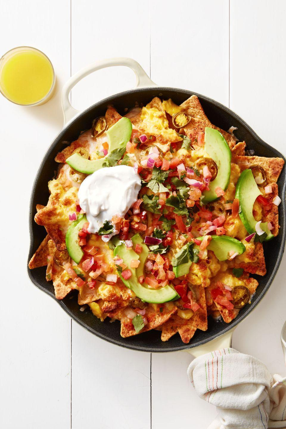 "<p>With eggs, cheese, jalapeños, avocado, and pico de gallo, these chilaquiles are basically nachos disguised as breakfast.</p><p><em><a href=""https://www.goodhousekeeping.com/food-recipes/a39354/mexican-breakfast-chilaquiles-recipe/"" rel=""nofollow noopener"" target=""_blank"" data-ylk=""slk:Get the recipe for Mexican Breakfast Chilaquiles »"" class=""link rapid-noclick-resp"">Get the recipe for Mexican Breakfast Chilaquiles » </a></em><br></p>"
