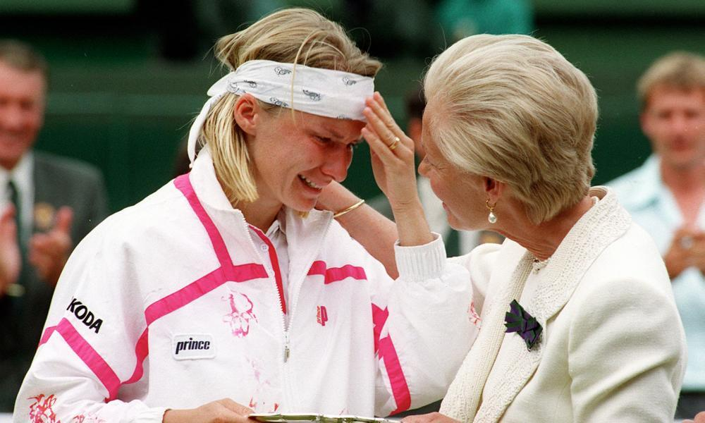 The Duchess of Kent comforts Jana Novotna as she presents her with the runner up trophy on centre court at Wimbledon