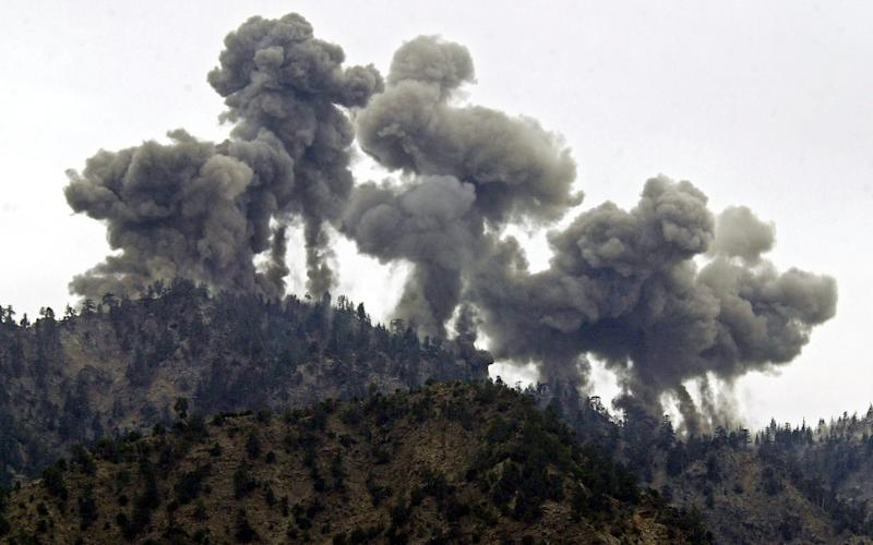 A multiple explosion rocks Al Qaeda positions in the Tora Bora mountains after an attack by US warplanes 14 December 2001 - EPA