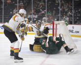 Minnesota Wild center Marcus Johansson (90) crashes against the net and Vegas Golden Knights goaltender Marc-Andre Fleury (29) during the first period in Game 3 of an NHL hockey first-round playoff series Thursday, May 20, 2021, in St. Paul, Minn. (Jeff Wheeler/Star Tribune via AP)