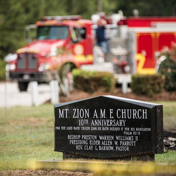 Fire engines arrive at the Mt. Zion AME Church in Greeleyville, South Carolina, on July 1, 2015 (AFP Photo/Sean Rayford)