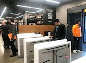 A shopper scans a smartphone app associated with his Amazon account and credit card information to enter the Amazon Go store in Seattle, Washington, U.S., January 18, 2018. Photo taken January 18, 2018. REUTERS/Jeffrey Dastin