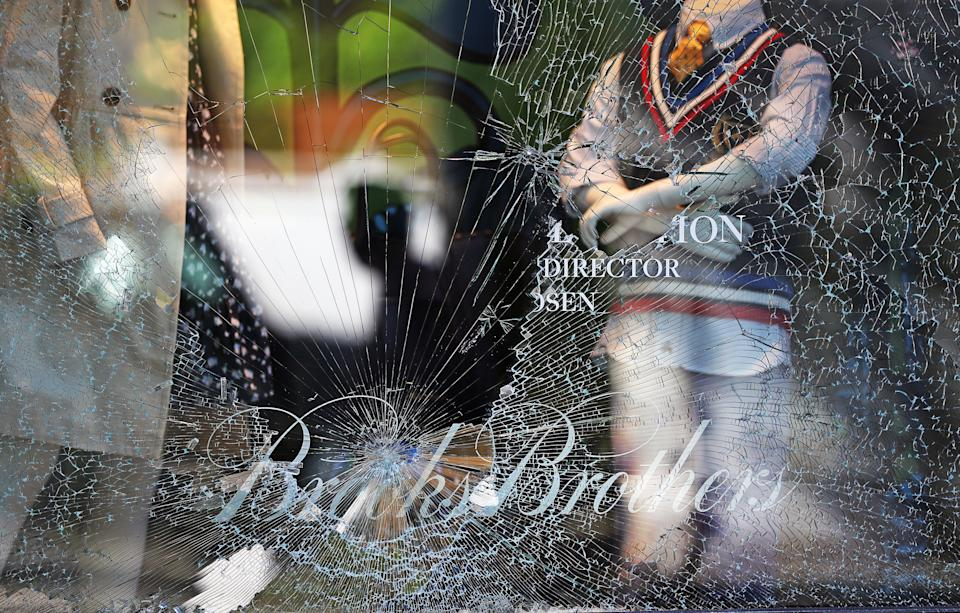 BOSTON, MA - MAY 31: Broken window at Brooks Brothers on Newbury street in Boston as people begin cleaning up on June 1, 2020 the morning after violent protests erupted in Boston. Peaceful protests all day on May 31 led to looting, vandalism and clashes with police at night. (Photo by David L. Ryan/The Boston Globe via Getty Images) (Photo: Boston Globe via Getty Images)