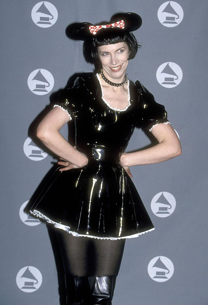 <p>We would rather walk on broken glass than relive Annie Lennox's Halloween-inspired Minnie Mouse costume at the 1995 Grammy Awards. (Image via Getty Images)</p>