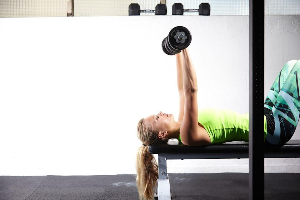"<p>You can perform a chest press on a bench, but Dolke says she prefers lying on the floor. ""You don't get the help from your legs, making it more of a challenge for the upper body! And since the range of motion stops at the floor, you place less strain on your shoulders,"" she adds. </p><p><strong>How to: </strong>Hold a dumbbell in each hand and rest it on your thighs as you lay supine with feet pressing into the floor. If you are on the floor, bend your knees. Your head, shoulders, and butt should make contact with the bench or floor for the whole movement. Draw your shoulders back and down, and lift the dumbbells overhead directly above your shoulders with palms facing forward with a good grip. Inhale as you lower the dumbbells slightly wider than your mid-chest slow and controlled, then exhale as you push them back up towards the ceiling.</p>"