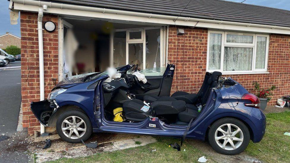 A car crashed into a bungalow in Cambridgeshire. (Police)