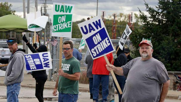PHOTO: John Kirk, right, a 20-year-employee, pickets with co-workers outside the General Motors Fabrication Division, Oct. 4, 2019, in Parma, Ohio. (Tony Dejak/AP)