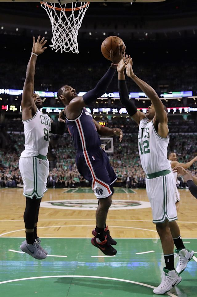<p>Washington Wizards guard John Wall, center, drives between Boston Celtics forward Jae Crowder, left, and center Al Horford during the second quarter of Game 7 of a second-round NBA basketball playoff series, Monday, May 15, 2017, in Boston. (AP Photo/Charles Krupa) </p>