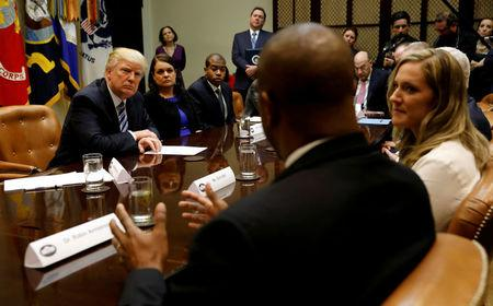 FILE PHOTO - U.S. President Donald Trump listens during a meeting about healthcare at the White House in Washington, U.S. on March 13, 2017. REUTERS/Kevin Lamarque/File Photo