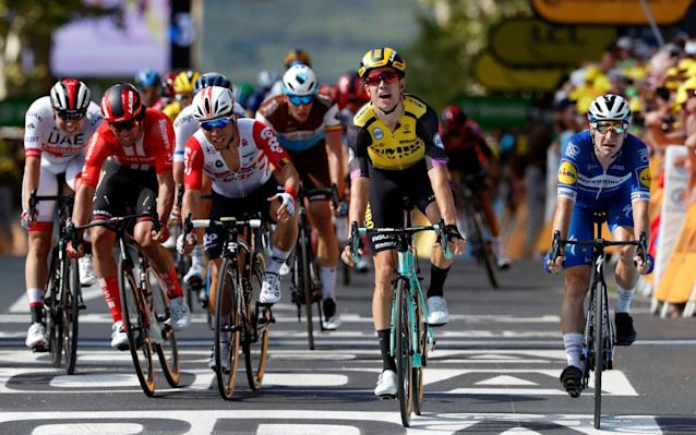 Belgium's Wout Van Aert, second from right, crosses the finish line to win the tenth stage of the Tour de France - AP