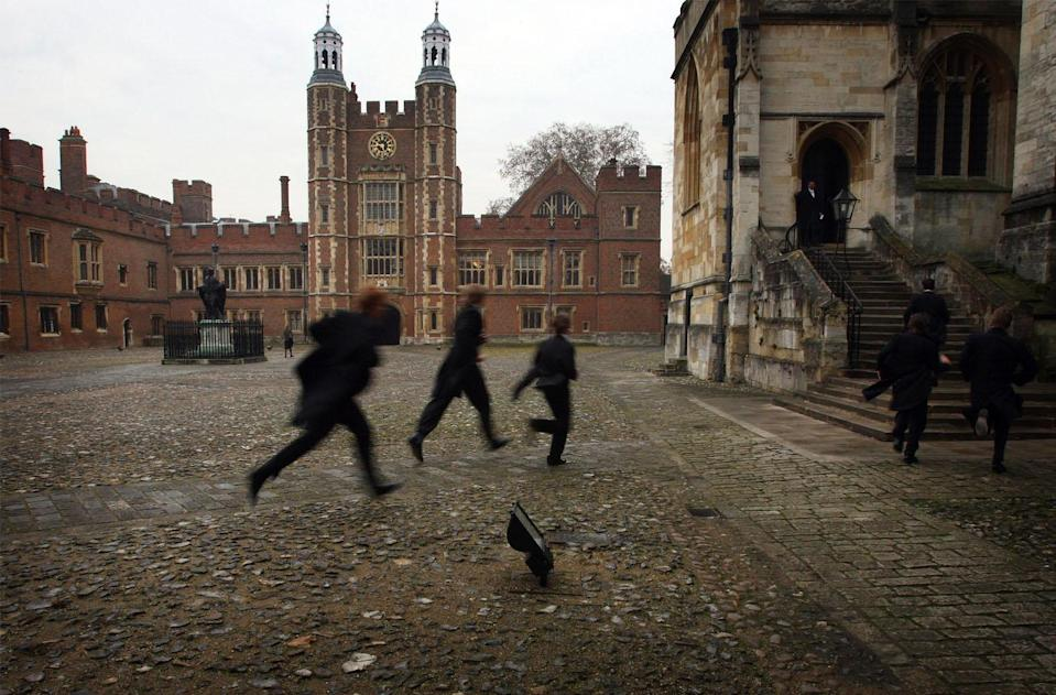 Boys run across the school yard of Eton College (Christopher Furlong/Getty Images)