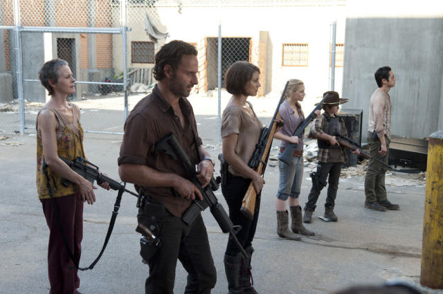 "Carol (Melissa Suzanne McBride), Rick Grimes (Andrew Lincoln), Maggie Greene (Lauren Cohan), Beth Greene (Emily Kinney), Carl Grimes (Chandler Riggs) and Glenn (Steven Yeun) in ""The Walking Dead"" episode, ""I Ain't a Judas."""